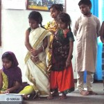 Madhu and Inia playing Vande Mataram on keyboard and all kids dressed in regional costumes
